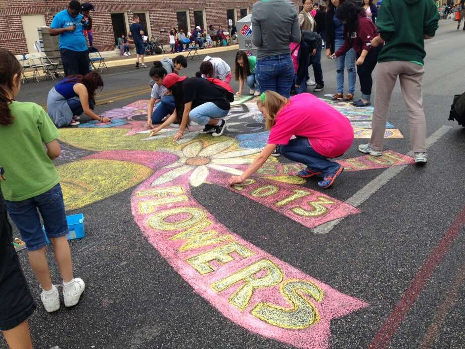 Students from Incarnate Word HS and St Anthony HS draw the BOF logo in chalk across from KLRN