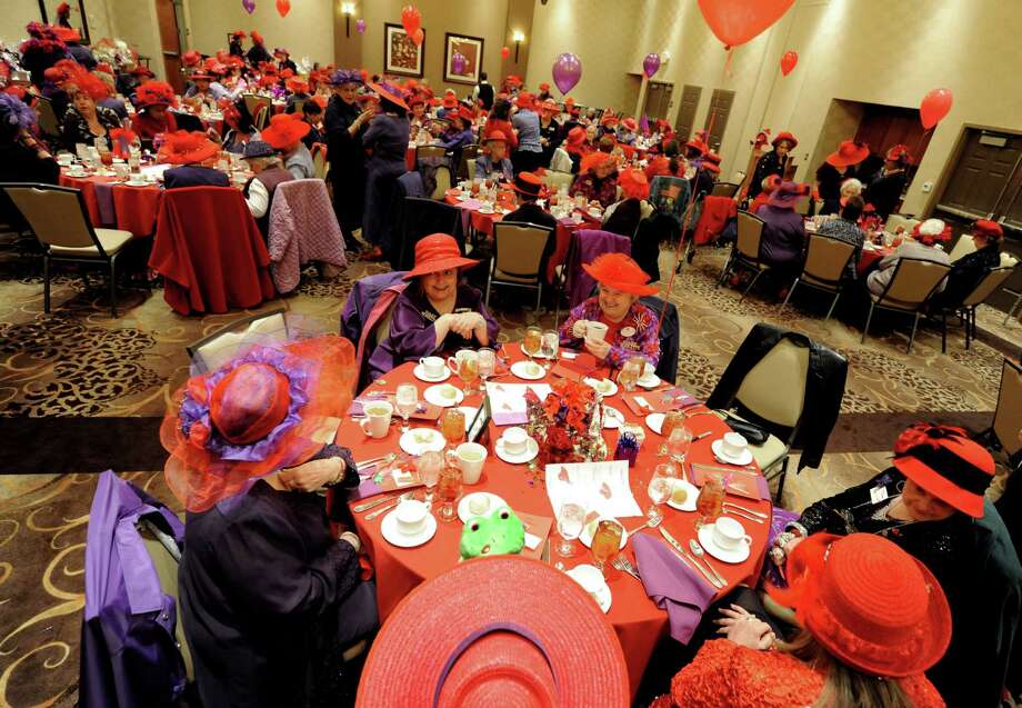 Area women wear their finest red hats during a national Red Hat Society day gathering at the Hilton Garden Inn in Clifton Park during on Thursday April 25, 2013 in Clifton Park, N.Y. The Spindle City Divas sponsored the event. (Michael P. Farrell/Times Union) Photo: Michael P. Farrell, Albany Times Union / 10022151A