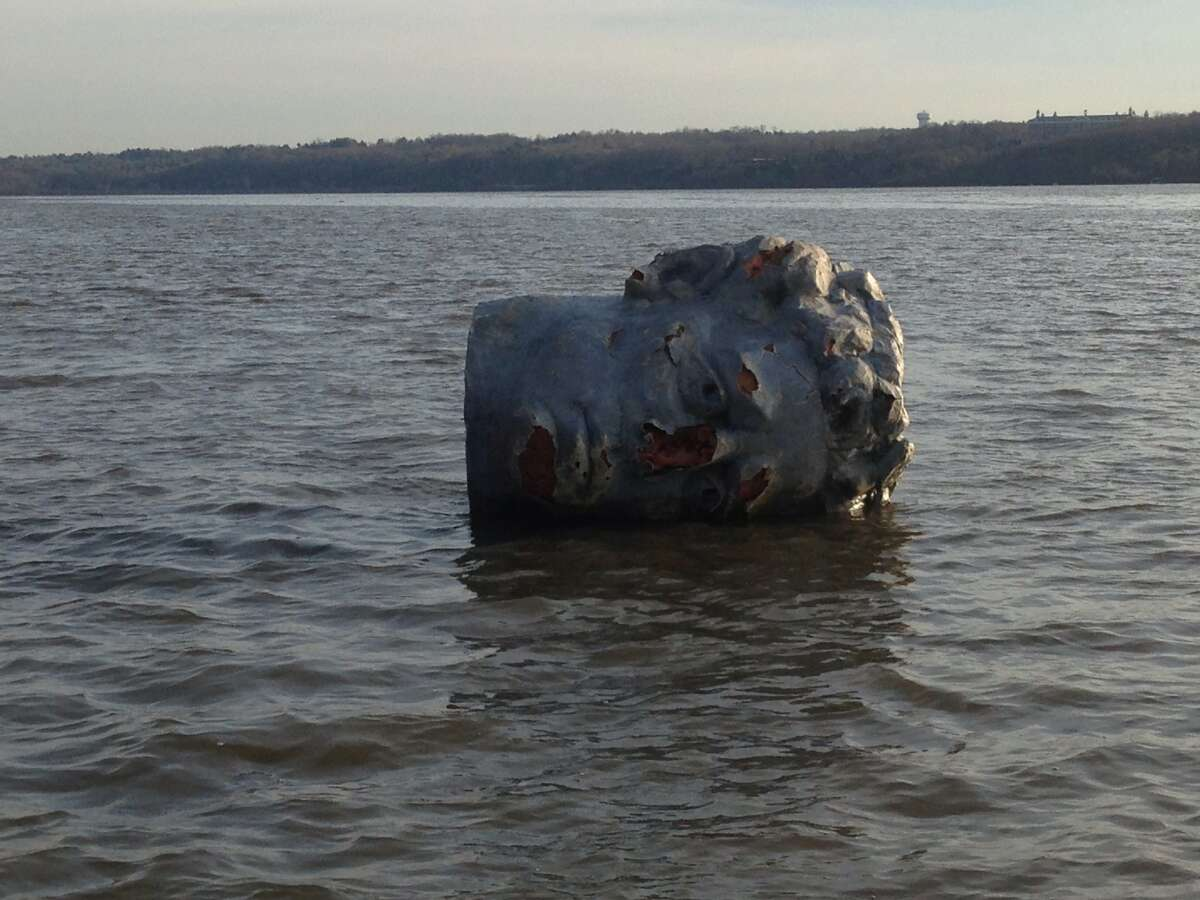 In this April 22, 2013 handout photo provided by Marist College crew coach Matthew Lavin, a giant head made of Styrofoam and fiberglass is seen floating in the Hudson River in Poughkeepsie, N.Y. Officials at the college in say their crew team was practicing earlier this week when the coach spotted a large object floating near the river's west bank. He hooked a rope to it and towed it to the team's dock on the east bank.