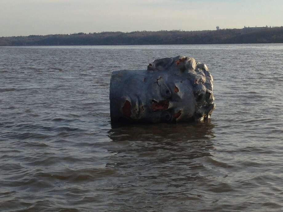 In this April 22, 2013 handout photo provided by Marist College crew coach Matthew Lavin, a giant head made of Styrofoam and fiberglass is seen floating in the Hudson River in Poughkeepsie, N.Y. Officials at the college in say their crew team was practicing earlier this week when the coach spotted a large object floating near the river's west bank. He hooked a rope to it and towed it to the team's dock on the east bank. Photo: AP / Marist College