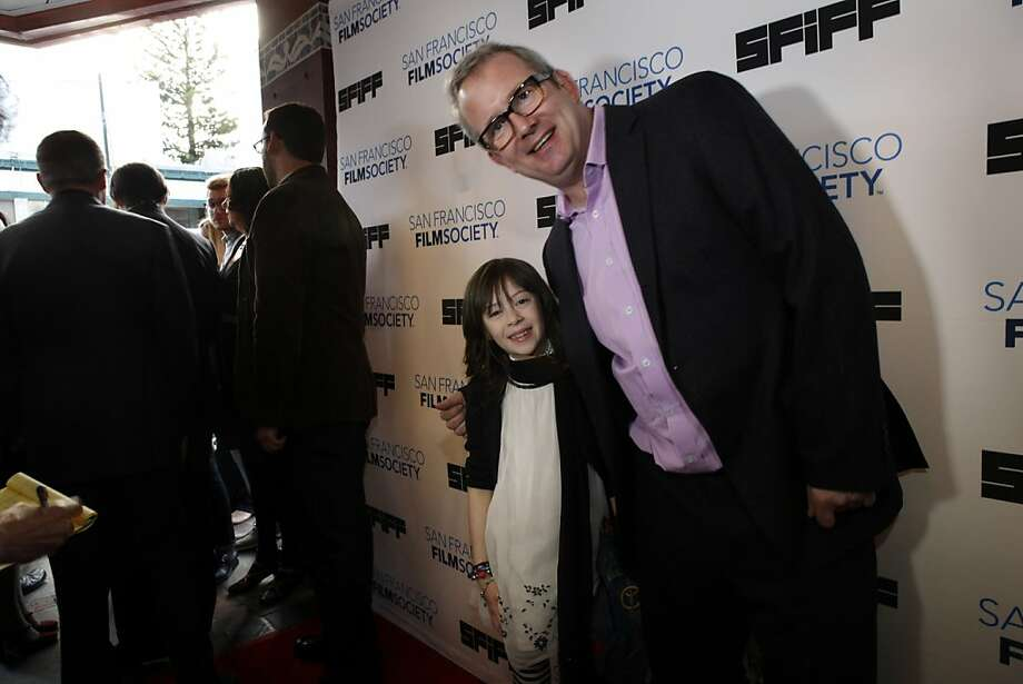"Onata Aprile, the star of the film, ""What Maisie Knew,"" poses with Ted Hope on the red carpet at the Castro Theater for the 56th San Francisco International Film Festival in San Francisco, Calif., on Thursday, April 25 2013. Photo: Carlos Avila Gonzalez, The Chronicle"
