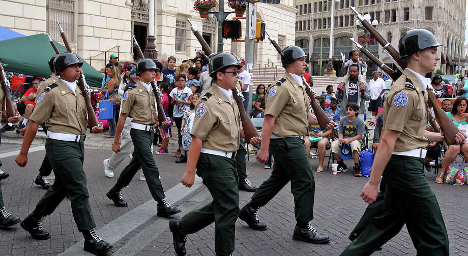 Cadets from Texas Military Institute form the vanguard as the Battle of Flowers Parade moves through the downtown area  on  April 26 2013. Photo: TOM REEL, Tom Reel / Express-News