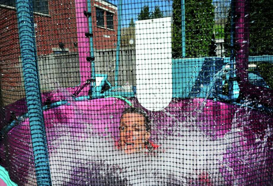 Fourth-grade teacher Kim Jansen goes under in the dunk tank during a fundraiser to fight autism at the Sherman School in Sherman, Conn. Friday, April 26, 2013. Photo: Michael Duffy / The News-Times