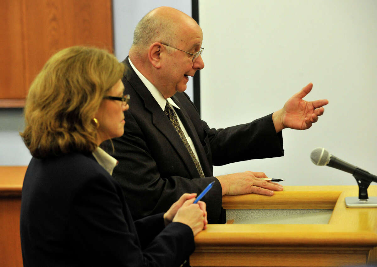 Assistant State's Attorney Susann Gill, left, and defense attorney Hubert Santos talk to Judge Thomas Bishop at Michael Skakel's habeas corpus trial at State Superior Court in Vernon, Conn., on Friday, April 26, 2013.