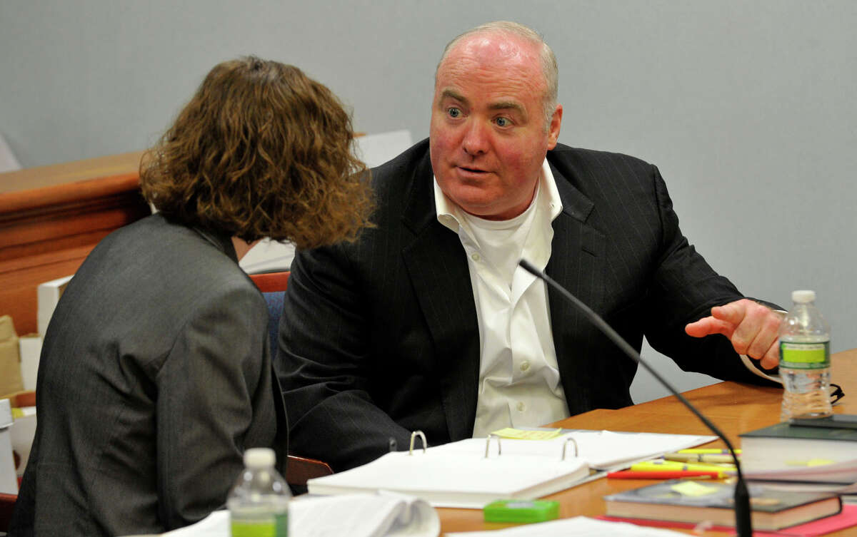 Michael Skakel, right, talks to Jessica Santos, one of his defense attorneys, at Skakel's habeas corpus trial at State Superior Court in Vernon, Conn., on Friday, April 26, 2013.