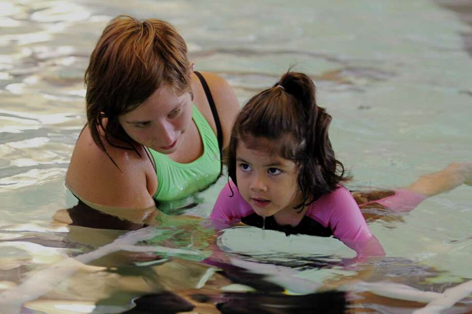 Make A Splash, a free water safety event hosted by Katy Aquatics and Texas Children's Hospital-West Campus, will be held 10 a.m.-noon on May 4 at the Cinco Ranch High School Natatorium, 23440 Cinco Ranch Blvd. Last year, Susanne Vigh of Katy Aquatics was teaching Daniela Rosas, 3½, how to swim. Photo: Suzanne Rehak, Freelance Photographer