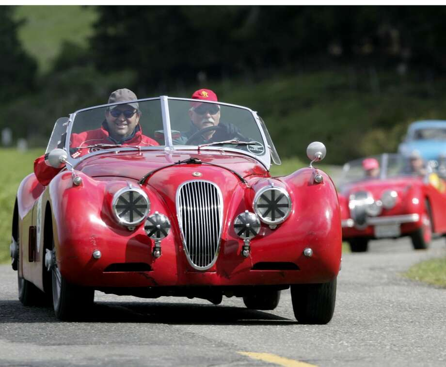 A pair of old Jaguars running the California Mille.