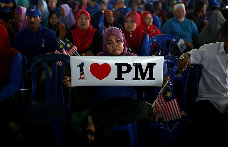 Obviously not a morning person:A woman rallies for Malaysian Premier Najib Razak, president of the ruling    National Front party in Kuala Kangsar. Opposition leader Anwar Ibrahim held a slight edge in the polls ahead of a   hotly anticipated election showdown May 5. Photo: Mohd Rasfan, AFP/Getty Images