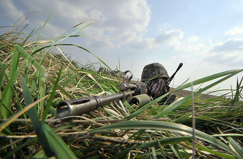 Zeroing in: A South Korean Marine sights his weapon during a joint landing operation by U.S and South Korean marines in   Pohang. South Korea staged the exercise in response to escalating tensions triggered by North Korea's nuclear   test in February. Photo: Jung Yeon-Je, AFP/Getty Images