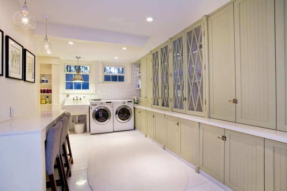 Laundry room of 1658 Federal Ave. E. The 7,380-square-foot Colonial-style mansion, built in 1919, has five bedrooms, five bathrooms, a two-story entry hall, a family room, a sun room, an office, a sitting room and a home theater on a nearly half-acre lot with two terraces, a play structure, a sports court, a storage shed with stone-clad walls and a built-in dog house, and a detached two-car garage topped by a dog run. It's listed for $4.25 million. Photo: Courtesy Mary Snyder And Bob Bennion, Windermere Real Estate