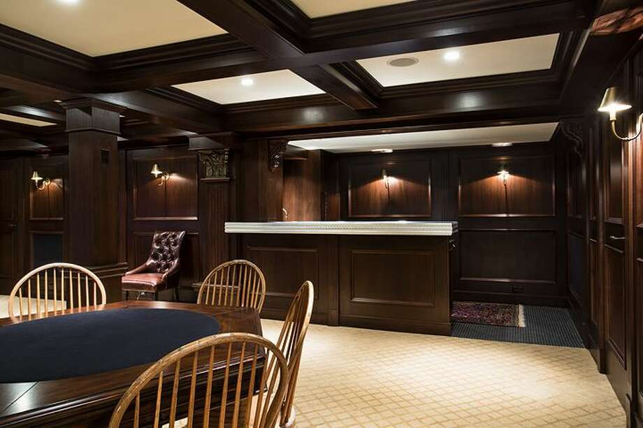 Basement theater of 1658 Federal Ave. E. The 7,380-square-foot Colonial-style mansion, built in 1919, has five bedrooms, five bathrooms, a two-story entry hall, a family room, a sun room, an office and a sitting room on a nearly half-acre lot with two terraces, a play structure, a sports court, a storage shed with stone-clad walls and a built-in dog house, and a detached two-car garage topped by a dog run. It's listed for $4.25 million. Photo: Courtesy Mary Snyder And Bob Bennion, Windermere Real Estate