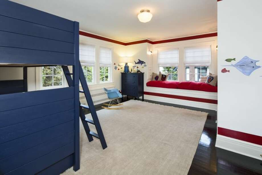 Bedroom of 1658 Federal Ave. E. The 7,380-square-foot Colonial-style mansion, built in 1919, has five bedrooms, five bathrooms, a two-story entry hall, a family room, a sun room, an office, a sitting room and a home theater on a nearly half-acre lot with two terraces, a play structure, a sports court, a storage shed with stone-clad walls and a built-in dog house, and a detached two-car garage topped by a dog run. It's listed for $4.25 million. Photo: Courtesy Mary Snyder And Bob Bennion, Windermere Real Estate
