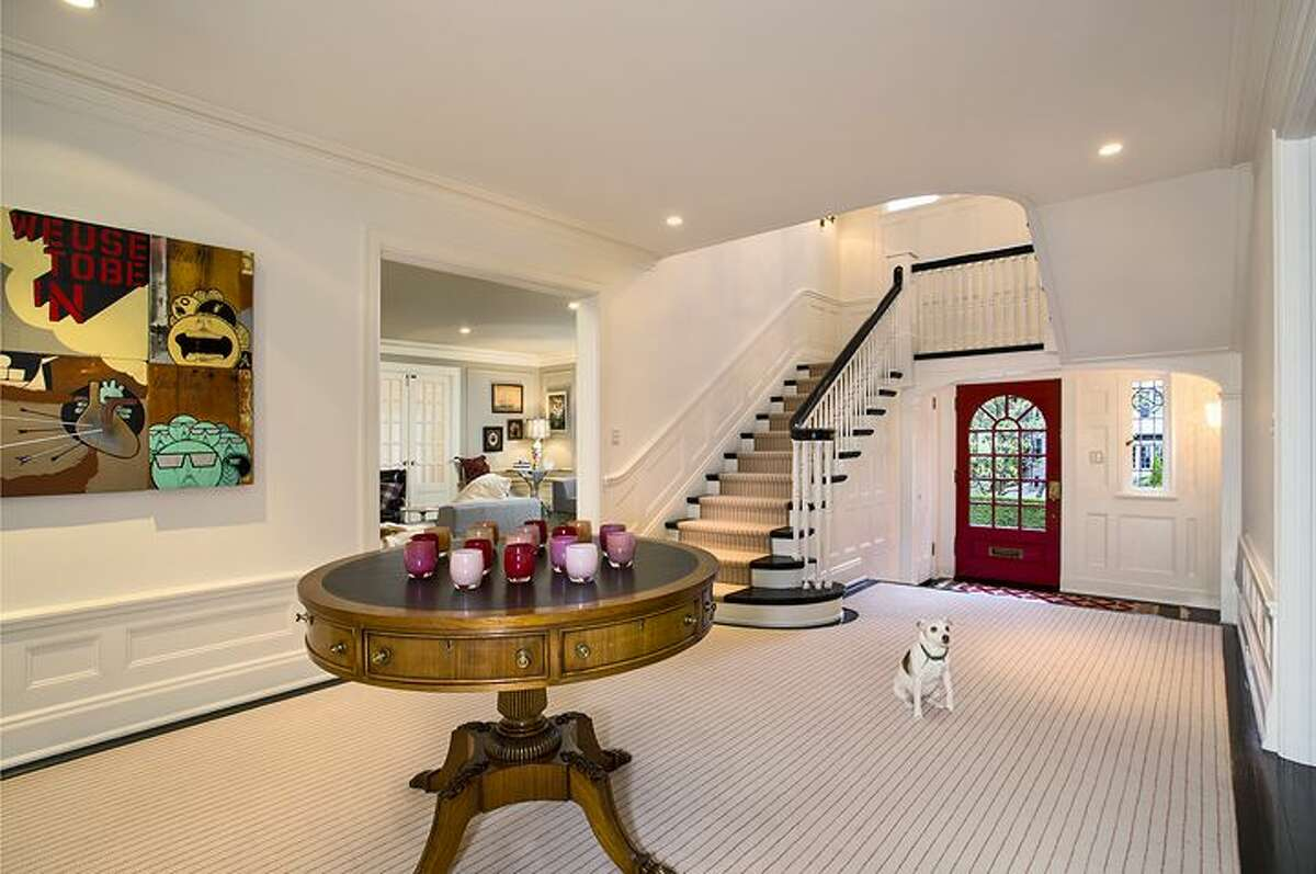Two-story entry hall of 1658 Federal Ave. E. The 7,380-square-foot Colonial-style mansion, built in 1919, has five bedrooms, five bathrooms, a family room, a sun room, an office, a sitting room and a home theater on a nearly half-acre lot with two terraces, a play structure, a sports court, a storage shed with stone-clad walls and a built-in dog house, and a detached two-car garage topped by a dog run. It's listed for $4.25 million.