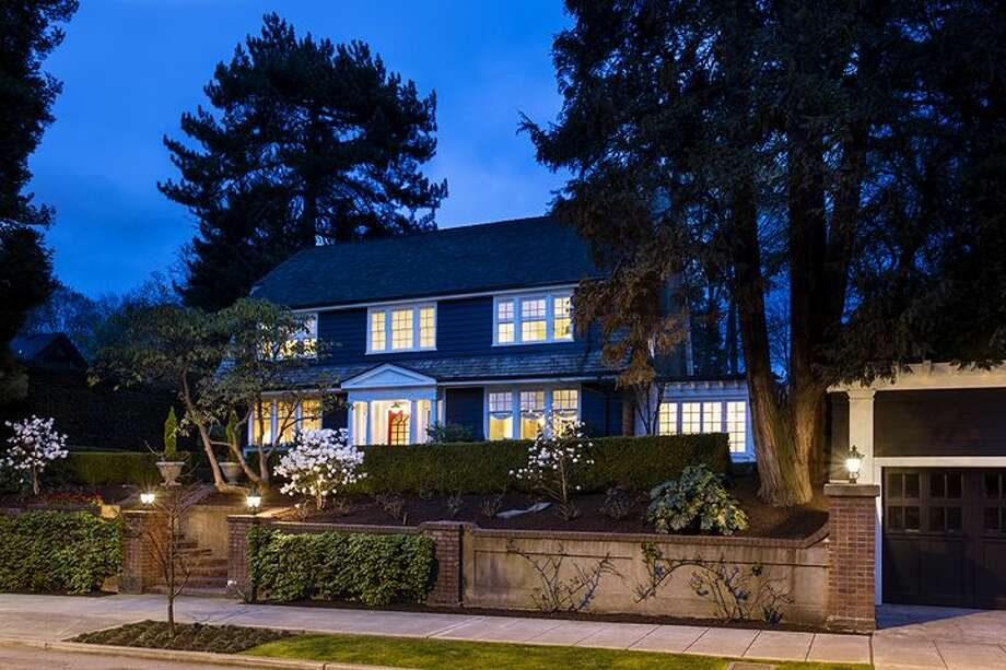 Want to live in a big home on a big lot on Capitol Hill? If you have $4.25 million, you could buy 1658 Federal Ave. E. The 7,380-square-foot Colonial-style mansion, built in 1919, has five bedrooms, five bathrooms, a two-story entry hall, a family room, a sun room, an office, a sitting room and a home theater on a nearly half-acre lot with two terraces, a play structure, a sports court, a storage shed with stone-clad walls and a built-in dog house, and a detached two-car garage topped by a dog run. Photo: Courtesy Mary Snyder And Bob Bennion,  Windermere Real Estate