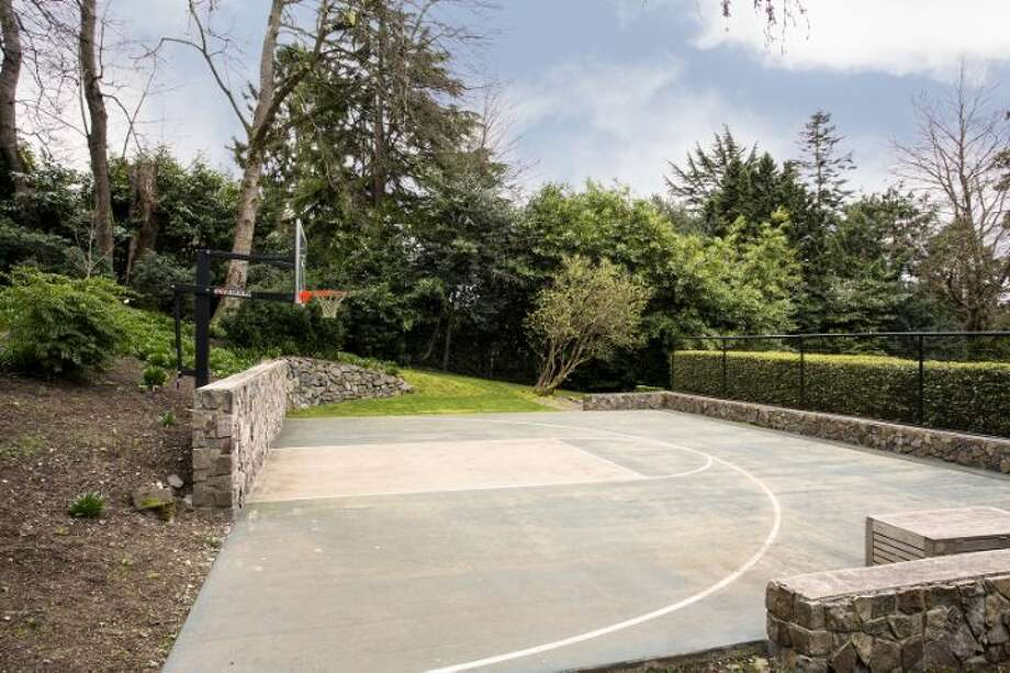 Sports court of 1658 Federal Ave. E. The 7,380-square-foot Colonial-style mansion, built in 1919, has five bedrooms, five bathrooms, a two-story entry hall, a family room, a sun room, an office, a sitting room and a home theater on a nearly half-acre lot with two terraces, a play structure, a storage shed with stone-clad walls and a built-in dog house, and a detached two-car garage topped by a dog run. It's listed for $4.25 million. Photo: Courtesy Mary Snyder And Bob Bennion, Windermere Real Estate