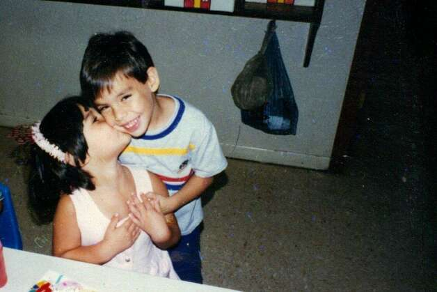Then: 1996, Anna Becerra, 2, gives her brother Kevin, 3, a kiss on the cheek. Photo: Becerra, Reader Submission