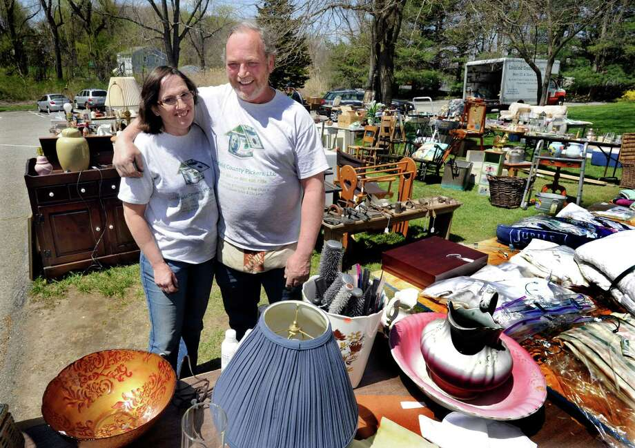 Dawn and Merton Larmore, owners of Litchfield Pickers L.L.C., in New Milford, Conn., are photographed amid a tag sale of merchandise, Friday, April 26, 2013. Photo: Carol Kaliff / The News-Times