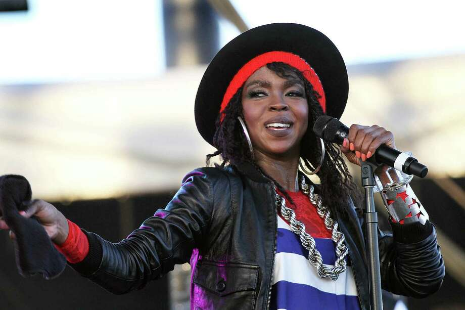 "FILE - This April 15, 2011 file photo shows singer Lauryn Hill performing during the 12th Coachella Valley Music and Arts Festival in Indio, Calif. Hill says she has signed with Sony to pay her overdue taxes. Hill pleaded guilty last year to not paying federal taxes on $1.8 million earned from 2005 to 2007. The 37-year-old posted on her Tumblr late Thursday that she ""signed a new record deal, and that I did this to pay taxes."" The total Hill owes is in dispute, but it is around $1 million. Her next sentencing is May 6. (AP Photo/Spencer Weiner, file) Photo: Spencer Weiner"