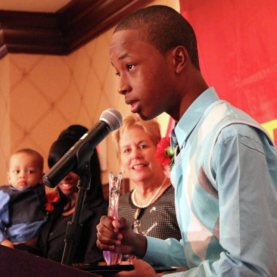 "Jonathan Dorvill of Stamford explains how he and his sister Rashidah saved their baby brother, who had stopped breathing. The siblings were among the honorees at the American Red Cross ""heroes'' breakfast Friday morning at the Trumbull Marriott. Photo: Frank Juliano / Connecticut Post"