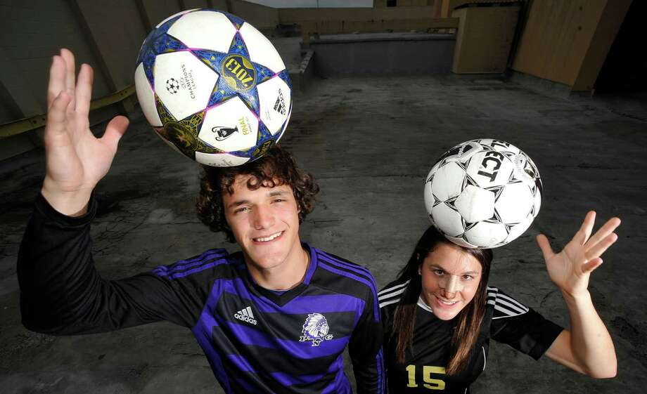 Port Neches-Groves forward Isaac Addison, left, is the boys 2013 Super Gold Soccer MVP of the Year and Nederland's Felicia Sauceda, right, is the 2013 girls Super Gold Soccer MVP of the Year.  Dave Ryan/The Enterprise Photo: Dave Ryan