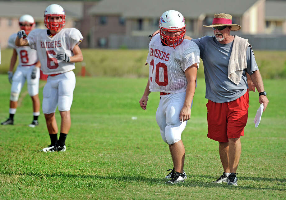 Lumberton coach Alvin Credeur instructs Edmund Horn during practice on Monday. Horn is shifting from fullback to the offensive line.  Photo taken Monday, August 27, 2012 Guiseppe Barranco/The Enterprise Photo: Guiseppe Barranco, STAFF PHOTOGRAPHER / The Beaumont Enterprise