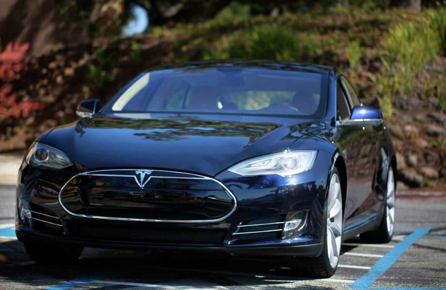 "The ""blue"" Tesla Model S sedan sits on display in the parking lot at Tesla Headquarters. Photo: Mike Kepka, The Chronicle / ONLINE_YES"