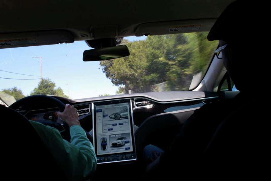 Members of the local press test drive the Tesla Model S sedan at the Tesla Headquarters. Photo: Mike Kepka, The Chronicle / ONLINE_YES
