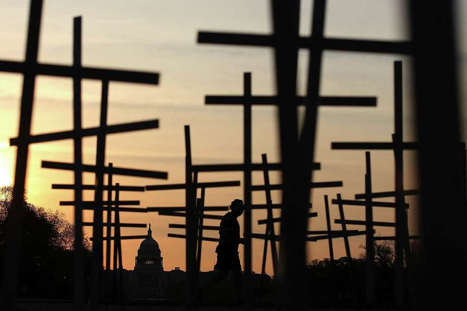 Volunteers placed more than 3,300 crosses, stars of David and other religious symbols April 11 on the National Mall in Washington, D.C. to remember those affected by gun violence. Photo: Mark Wilson, Staff / 2013 Getty Images