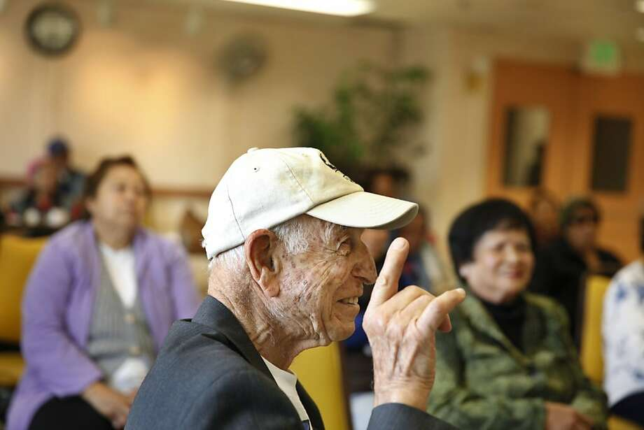 Amin Muwafi makes a point during a consumer and nutrition education class at the 30th Street Senior Center in S.F. Photo: Lea Suzuki, The Chronicle