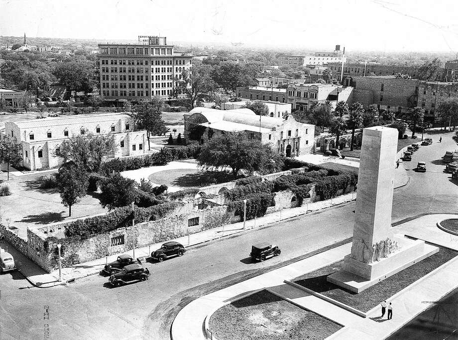 This 1939 photo of the Alamo grounds shows the newly completed Cenotaph out front. One group originally wanted to erect an 802-foot tower, but the smaller Cenotaph was built instead. Photo: Express-News File Photo / EXPRESS-NEWS FILE PHOTO
