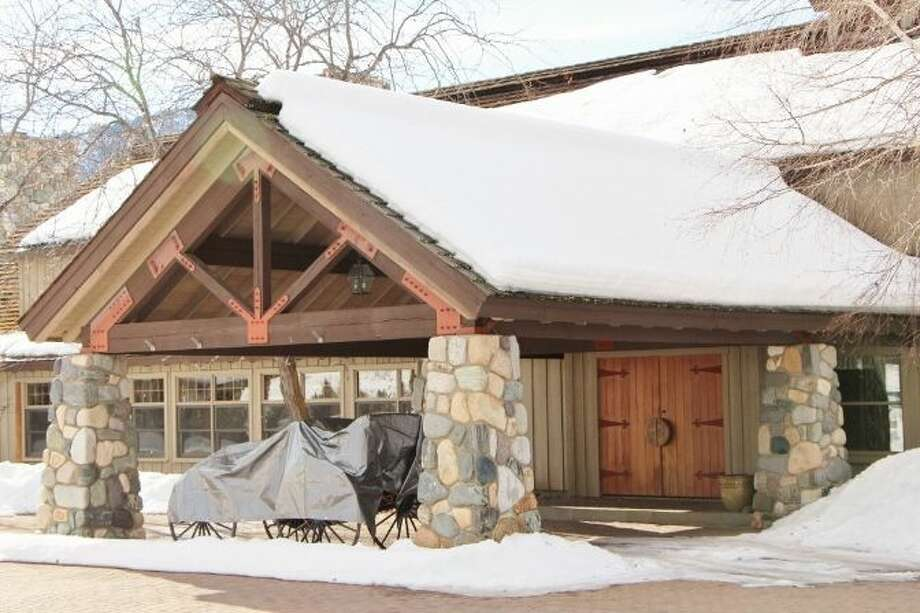 Main lodge of Tice Ranch, at 20556a Highway 20, east of Twisp. The 298.4-acre ranch includes a 20,000-square-foot main lodge, two guest houses, a caretaker residence, a horse barn, fenced pastures, fruit orchards and a half mile of river frontage. It's listed for $7.19 million. Photo: Courtesy Brad Vancour, Windermere Real Estate