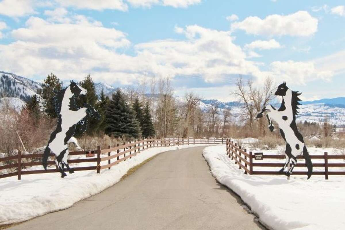 Entry to Tice Ranch, at 20556a Highway 20, east of Twisp. The 298.4-acre ranch includes a 20,000-square-foot main lodge, two guest houses, a caretaker residence, a horse barn, fenced pastures, fruit orchards and a half mile of river frontage. It's listed for $7.19 million.