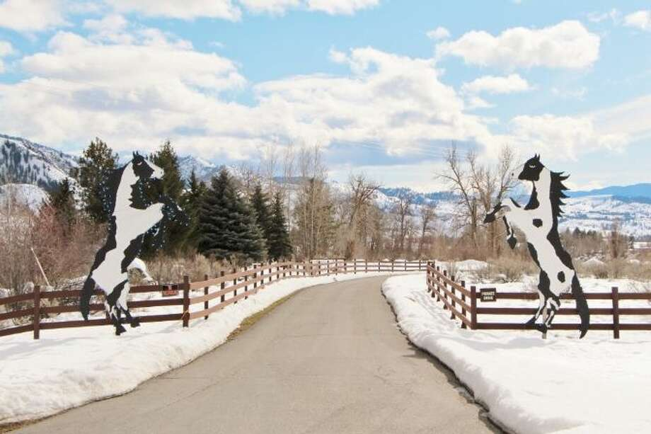 Entry to Tice Ranch, at 20556a Highway 20, east of Twisp. The 298.4-acre ranch includes a 20,000-square-foot main lodge, two guest houses, a caretaker residence, a horse barn, fenced pastures, fruit orchards and a half mile of river frontage. It's listed for $7.19 million. Photo: Courtesy Brad Vancour, Windermere Real Estate