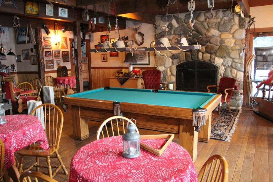 Bar of Tice Ranch, at 20556a Highway 20, east of Twisp. The 298.4-acre ranch includes a 20,000-square-foot main lodge, two guest houses, a caretaker residence, a horse barn, fenced pastures, fruit orchards and a half mile of river frontage. It's listed for $7.19 million. Photo: Courtesy Brad Vancour, Windermere Real Estate
