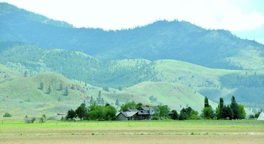 View of Tice Ranch, at 20556a Highway 20, east of Twisp. The 298.4-acre ranch includes a 20,000-square-foot main lodge, two guest houses, a caretaker residence, a horse barn, fenced pastures, fruit orchards and a half mile of river frontage. It's listed for $7.19 million. Photo: Courtesy Brad Vancour, Windermere Real Estate