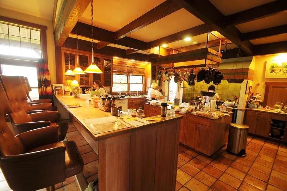 Kitchen of Tice Ranch, at 20556a Highway 20, east of Twisp. The 298.4-acre ranch includes a 20,000-square-foot main lodge, two guest houses, a caretaker residence, a horse barn, fenced pastures, fruit orchards and a half mile of river frontage. It's listed for $7.19 million. Photo: Courtesy Brad Vancour, Windermere Real Estate