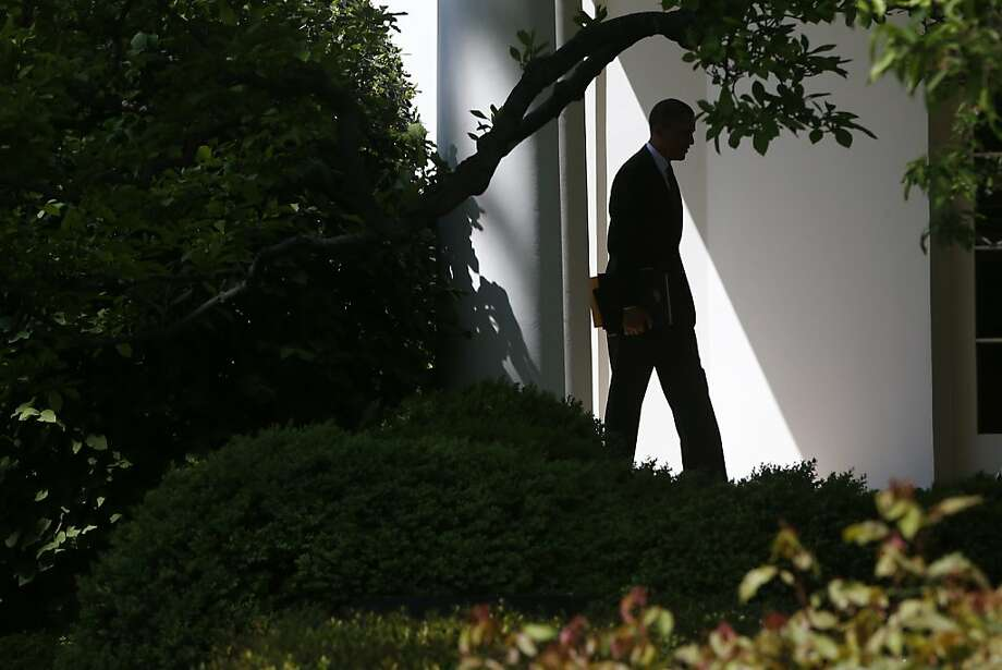 President Barack Obama walks back to the Oval Office of the White House in Washington, Friday, April 26, 2103, upon his returned from speaking at the 2013 Planned Parenthood National Conference in Washington, Friday, April 26, 2013. (AP Photo/Charles Dharapak) Photo: Charles Dharapak, Associated Press