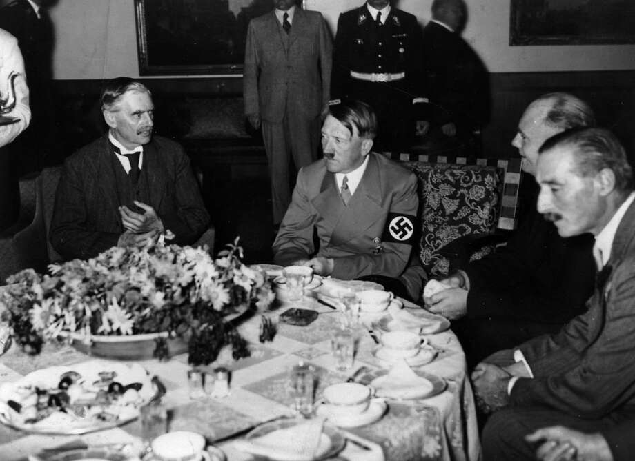 British Prime Minister Neville Chamberlain met with Adolf Hitler in Munich in 1938. Hitler's Germany continued to grow stronger after the appeasement meeting, eventually leading to WWII. Photo: Heinrich Hoffmann, Getty Images