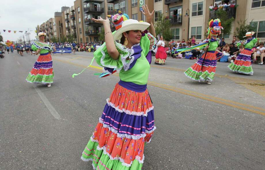 Dancers from St. Edwards University's Ballet Folklorico perform during the Battle of Flowers Parade on Friday, Apr. 26, 2013. Photo: Kin Man Hui, San Antonio Express-News / © 2013 San Antonio Express-News