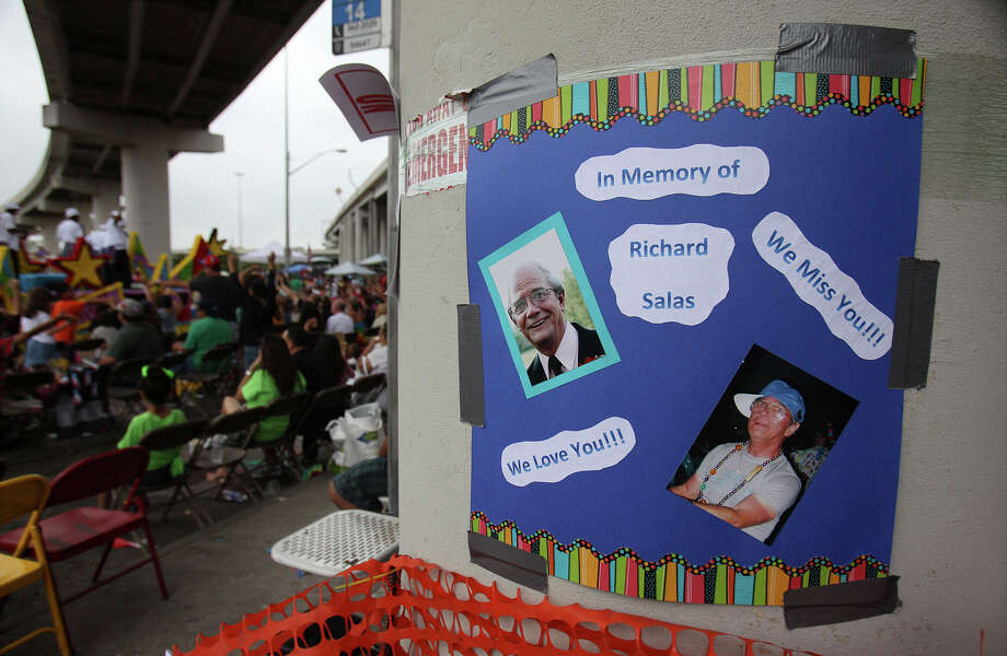 A poster in memory of Richard Salas is posted on a pillar where he and his family watched the parade for nearly 30 years is seen at the Battle of Flowers Parade on Friday, Apr. 26, 2013. Photo: Kin Man Hui, San Antonio Express-News / © 2013 San Antonio Express-News