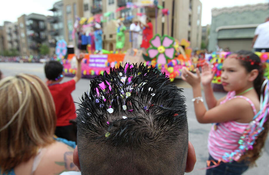 Robert Balderas' hair contains remnants of a cascarone while he and his family watched the Battle of Flowers Parade on Friday, Apr. 26, 2013. Photo: Kin Man Hui, San Antonio Express-News / © 2013 San Antonio Express-News