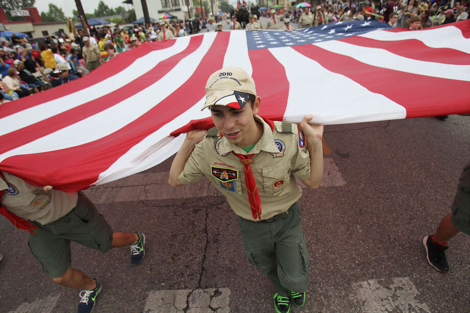 Scouts from the Alamo Area Council of Boy Scouts of America carry the U.S. Flag at the Battle of Flowers Parade on Friday, Apr. 26, 2013. Photo: Kin Man Hui, San Antonio Express-News / © 2013 San Antonio Express-News