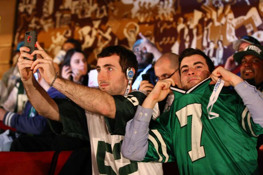 Jets fans at Radio City Music Hall during the 2013 NFL Draft.