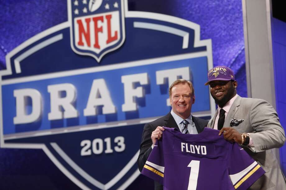 Sharrif Floyd stands with Roger Goodell after being selected 23rd overall by the Minnesota Vickings.