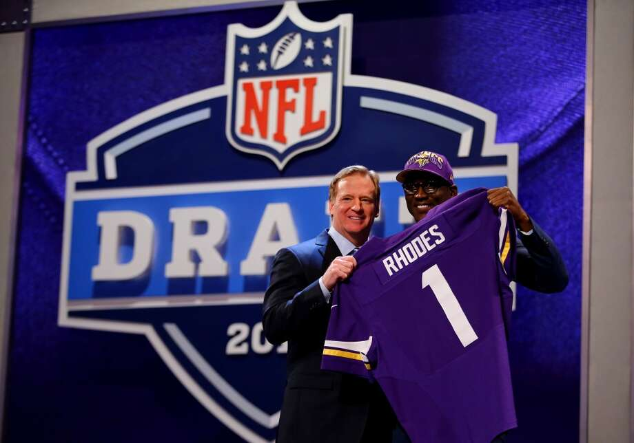 Xavier Rhodes stands with NFL Commissioner Roger Goodell after being picked #25 overall by the Minnesota Vikings.