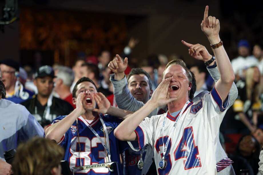 Buffalo Bills fans cheer as their team picks during the first round.
