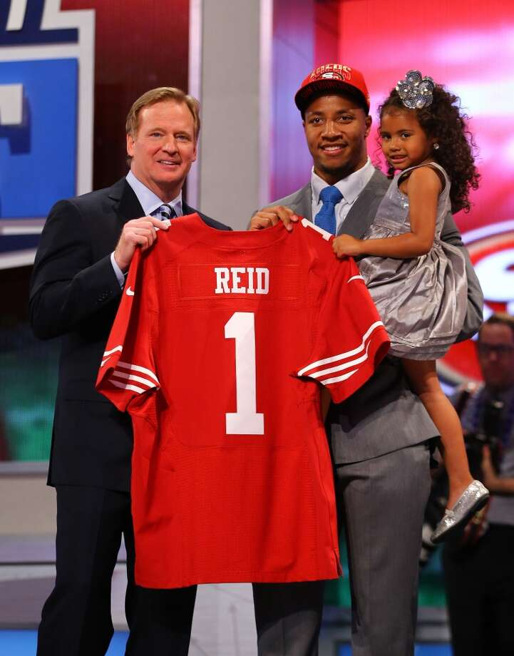NEW YORK, NY - APRIL 25:  Eric Reid holds his daughter Leilani on stage after being picked #18 overall by the San Francisco 49ers.