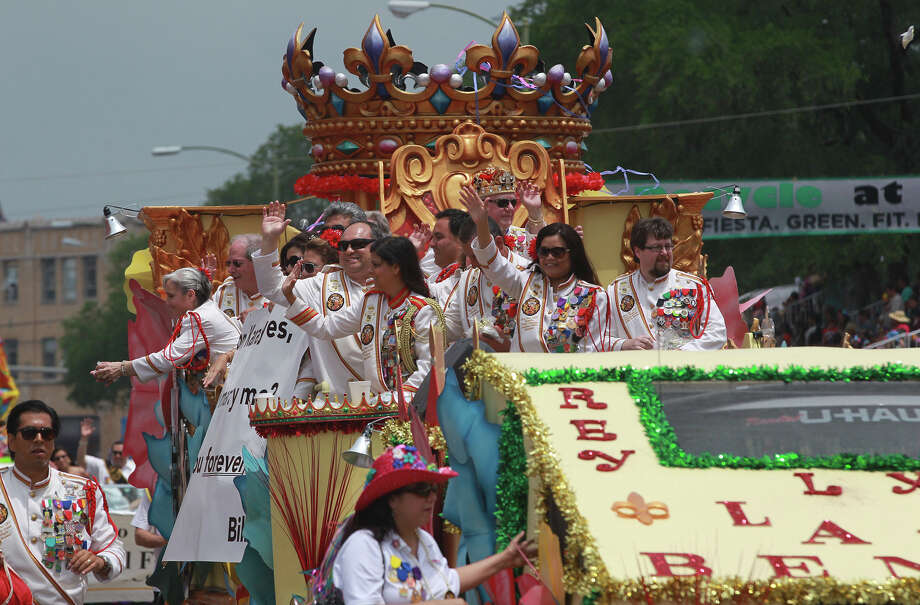The El Rey Feo float travels down the 900 block of Broadway Friday April 26, 2013 during the Battle of Flowers Parade. Photo: JOHN DAVENPORT, SAN ANTONIO EXPRESS-NEWS / ©San Antonio Express-News/Photo may be sold to the public