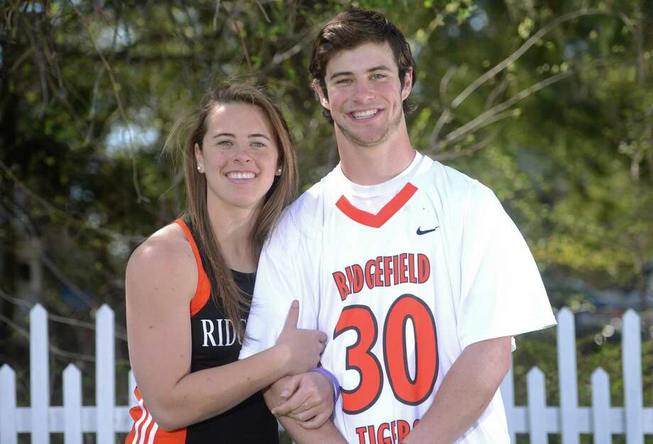 Ridgefield seniors Ellie and Sam Gravitte pose at their home in Ridgefield, Conn. on Friday, April 26, 2013.  The twins are star athletes at their school, with Ellie throwing javelin and Sam playing lacrosse and football. Photo: Tyler Sizemore / The News-Times