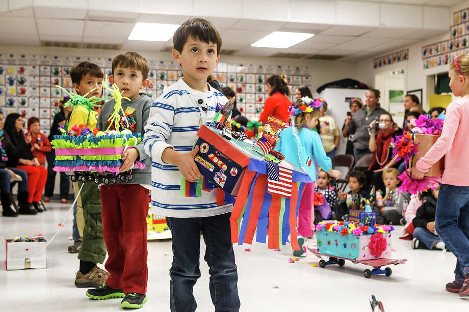 First- and second-graders participate in a shoebox parade during Discovery School's Mini-Fiesta, a two-day event with the parade, mariachis and dancing on April 24 and 25. Photo: Marvin Pfeiffer / North Central News / Prime Time Newspapers 2013